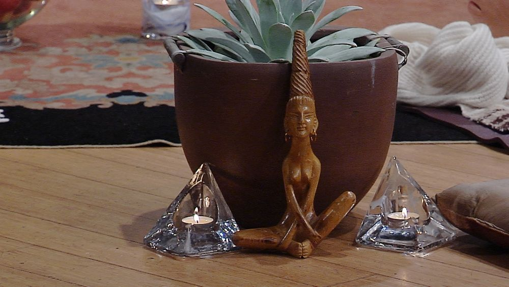 deity and succulent crystals with candles at our evening yoga class
