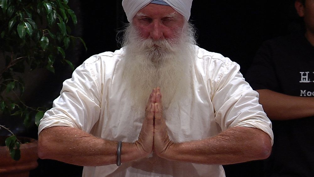 Sukhmandir Singh doing quiet meditation of the flowing heart anjali