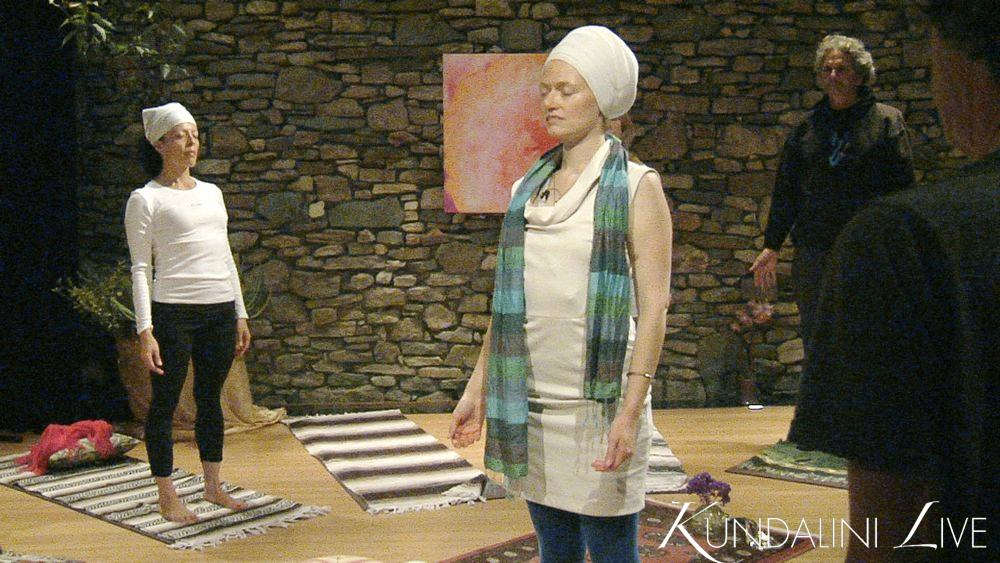 girls with brick wall breathing deeply power meditation yoga
