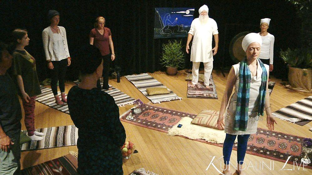 tadasana eyes closes yoga classroom breathing deep with concentration and focus