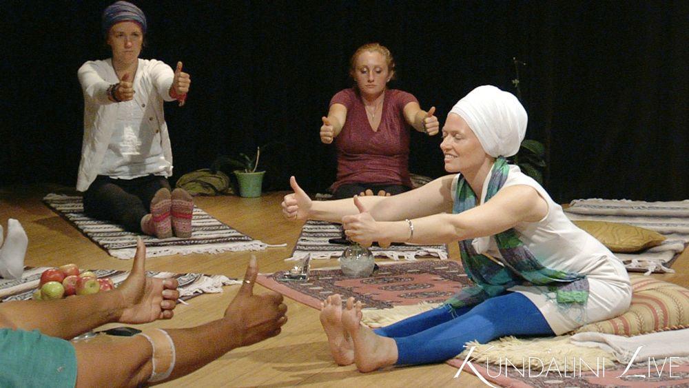 thumbs-up forward fold yoga asanasmiling women stretching