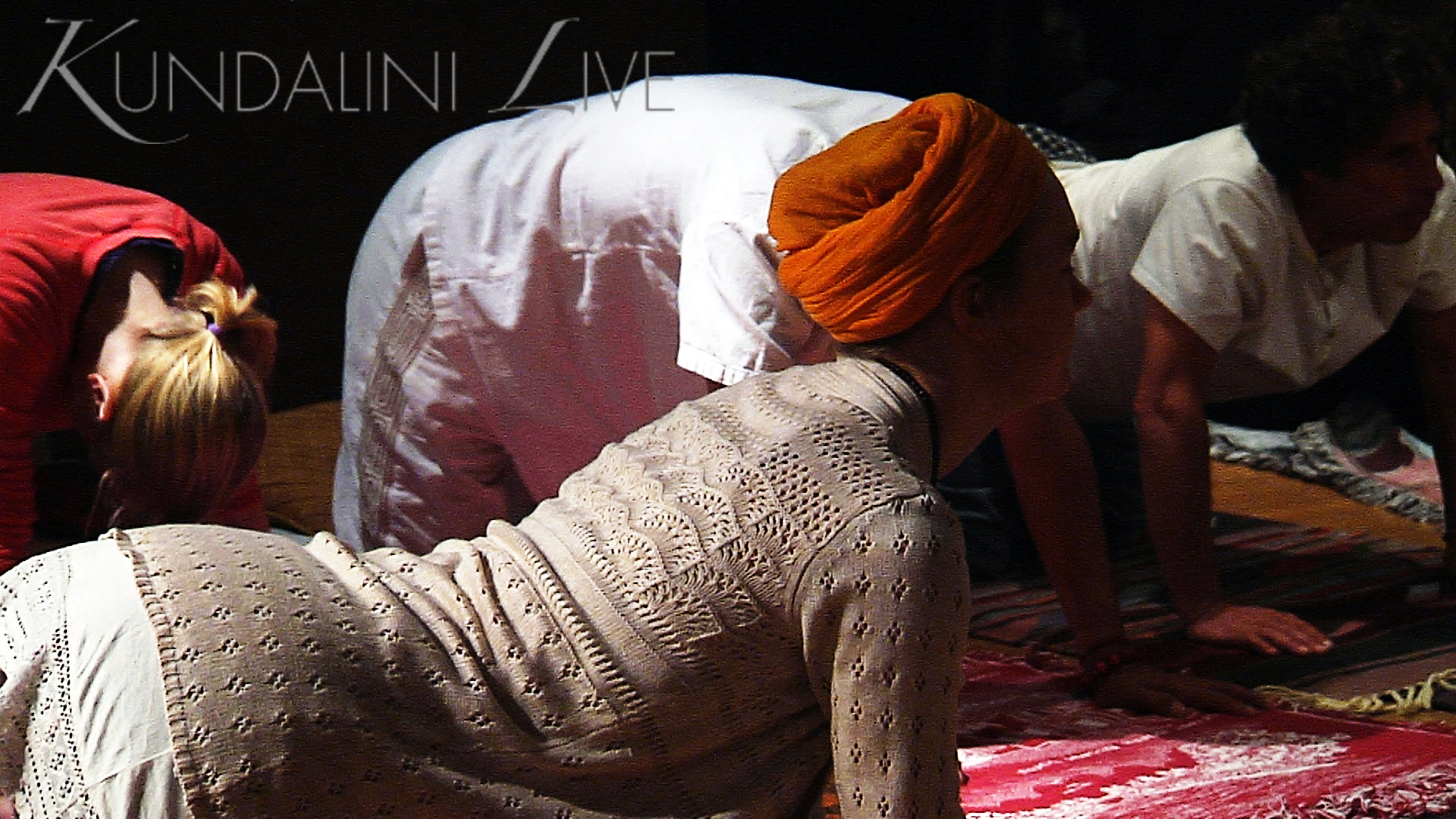 girl in orange turban doing dynamic cat cow hatha yoga posture for wellness happiness and peace of mind